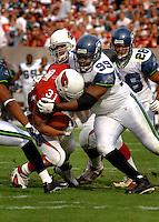 Nov. 6, 2005; Tempe, AZ, USA; Defensive Tackle (99) Rockey Bernard of the Seattle Seahawks tackles Arizona Cardinals running back (31) Marcel Shipp at Sun Devil Stadium. Mandatory Credit: Mark J. Rebilas