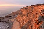 Coastal cliffs near Greyhound Rock at sunset