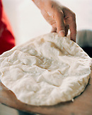 OMAN,  Muscat, person making flat bread, close-up