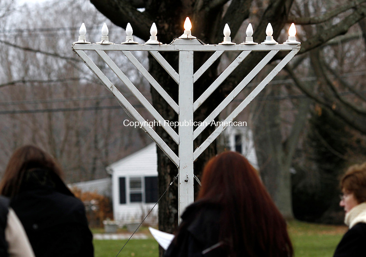 Middlebury, CT- 16 December 2014-121614CM07- country life only please---  Members of the community along with students and staff from Westover School, sing Hanukkah songs during the annual Menorah Lighting on the Middlebury Green on Tuesday. The ceremony was arranged by the Middlebury Congregational Church, which owns the Green, and Westover School, whose maintenance staff sets up the menorah, as a gift to their Jewish neighbors.   Christopher Massa Republican-American