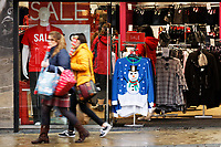 Last minute Christmas shoppers in Oxford Street, in the city centre of Swansea, Wales, UK. Sunday 24 December 2017