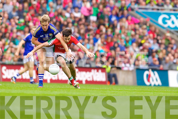 Donnchadh Walsh Kerry in action against Michael Geaney Mayo in the All Ireland Senior Football Semi Final in Croke Park on 24th August 2014.