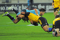 Ma'a Nonu tackles Adam Ashley-Cooper during the Super Rugby match between the Hurricanes and Waratahs at Westpac Stadium, Wellington, New Zealand on Saturday, 18 April 2015. Photo: Dave Lintott / lintottphoto.co.nz