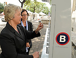 Under the watchful eye of Houston's Sustainability Director Laura Spanjian, Mayor Annise Parker tests out the self-service B-cycle station outside City Hall Monday April 30,2012. (Dave Rossman Photo)