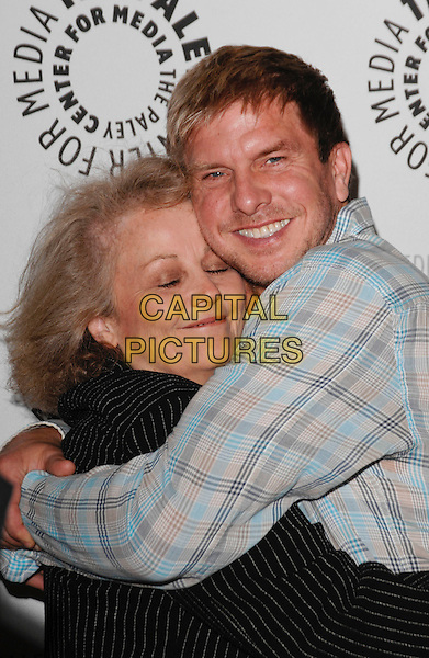 "NANCY MILLER & KENNY JOHNSON .arriving at the Third Season Premiere and Panel Discussion for ""Saving Grace"" at The Paley Center for Media in Beverly Hills, California, USA, June 13th 2009..half length hugging embracing  black suit pinstripe jacket plaid check checked grey gray shirt blue .CAP/ROT.©Lee Roth/Roth Stock/Capital Pictures."