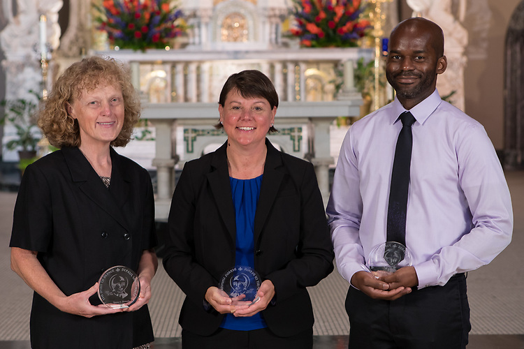 Left to right, Teresa Skwarek, Fran Cebrzynski, and Darren Davis were presented with Spirit of DePaul Awards during DePaul's annual Academic Convocation at the St. Vincent de Paul Parish Church Thursday, Aug. 31, 2017. A. Gabriel Esteban, Ph.D., president of DePaul University, presented the awards to faculty and staff. (DePaul University/Jeff Carrion)