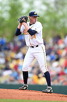 Montgomery Biscuits pitcher Mike Colla (34) gets ready to deliver a pitch during a game against the Mississippi Braves on April 22, 2014 at Riverwalk Stadium in Montgomery, Alabama.  Mississippi defeated Montgomery 6-2.  (Mike Janes/Four Seam Images)