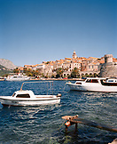 CROATIA, Korcula, Dalmatian Coast, Island, boat moored at Korcula Island with buildings in the background