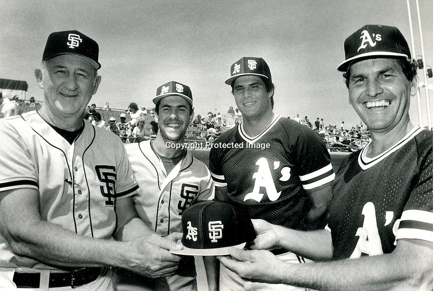 Oakland A's and San Francisco Giants meet before the 1986 Major League baseball season. showing off the duel logo caps, Giants manager Roger Craig and Will Clark, Athletics Jose Canseco and manager Jackie Moore. (1986 photo/Ron Riesterer)