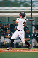 GCL Pirates third baseman Patrick Dorrian (50) follows through on a swing during the first game of a doubleheader against the GCL Yankees East on July 31, 2018 at Pirate City Complex in Bradenton, Florida.  GCL Yankees East defeated GCL Pirates 2-0.  (Mike Janes/Four Seam Images)