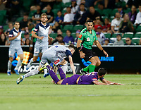 1st February 2020; HBF Park, Perth, Western Australia, Australia; A League Football, Perth Glory versus Melbourne Victory; Joel Chianese of the Perth Glory falls to the pitch after a heavy tackle from Anthony Lesiotis from Melbourne Victory