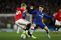 30th October 2019; Stamford Bridge, London, England; English Football League Cup, Carabao Cup, Chelsea Football Club versus Manchester United; Billy Gilmour of Chelsea challenges Brandon Williams of Manchester Utd - Strictly Editorial Use Only. No use with unauthorized audio, video, data, fixture lists, club/league logos or 'live' services. Online in-match use limited to 120 images, no video emulation. No use in betting, games or single club/league/player publications