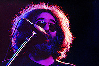 Jerry Garcia with The Grateful Dead Live at Huntington West Virginia 16 April 1978. A tight shot of Jerry singing into the mic. Halo of light in his hair.