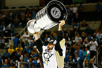 Kris Letang #58 of the Pittsburgh Penguins hoists the Stanley Cup following their 3-1 win against the San Jose Sharks during game six of the Stanley Cup Final at SAP Center in San Jose, California on June 12, 2016. (Photo by Jared Wickerham / DKPS)