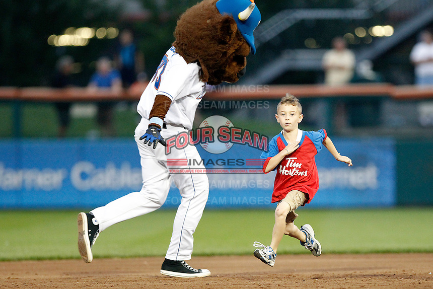 Buffalo Bisons mascot Buster Bison in a base race with a young fan during a game against the Syracuse Chiefs at Coca-Cola Field on September 1, 2011 in Buffalo, New York.  Syracuse defeated Buffalo 6-2.  (Mike Janes/Four Seam Images)
