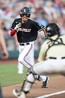 Louisville Cardinals Pinch runner Trey Leonard (14) runs towards the plate during Game 12 of the NCAA College World Series against the Vanderbilt Commodores on June 21, 2019 at TD Ameritrade Park in Omaha, Nebraska. Leonard was out at the plate, as Vanderbilt defeated Louisville 3-2. (Andrew Woolley/Four Seam Images)