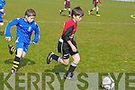 St Brendan's Park's Gearoid Dillane and Killarney Athletic's Luke Ring...