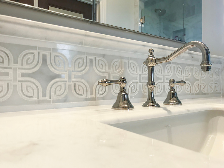 """6 3/4"""" Heathrow border, a hand-cut and waterjet mosaic shown in honed Thassos and Afyon White with tumbled Thassos, is part of the Miraflores collection by Paul Schatz for New Ravenna."""