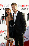 "HOLLYWOOD, CA. - July 16: Roselyn Sanchez and Eric Winter  arrive at the Los Angeles premiere of ""The Ugly Truth"" held at the Pacific's Cinerama Dome on July 16, 2009 in Hollywood, California."