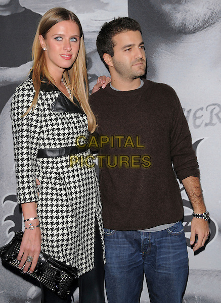 "NICKY HILTON & DAVID KATZENBERG .Attends The Berkela Films & Vas Entertainment L.A. Screening of ""Bra Boys"" held at The DGA in West Hollywood, California, USA, .April 07 2008.                                                                    full length black and white houndstooth check coat jacket clutch bag couple top jeans .CAP/DVS.©Debbie VanStory/Capital Pictures"