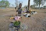 Nidier Atak cooks wild leaves in Rumading, a village in South Sudan's Lol State where more than 5,000 people, displaced by drought and conflict, remain in limbo. Atak and her five children left their home in Wanalel in January 2017 after successive crop failures left them with no other options. They set out walking for Sudan, seeking better conditions, but stopped at Rumading when they met others who had been violently turned back at the border. So they remain camped out under trees, eating wild leaves as the rainy season approaches. Her husband had left home looking for work months earlier, and she doesn't know where he is.<br /> <br /> In early April, Norwegian Church Aid, a member of the ACT Alliance, began drilling a well in the informal settlement and distributed sorghum, beans and cooking oil to the most vulnerable families. It is carrying out the emergency assistance in coordination with government officials and the local Catholic parish.