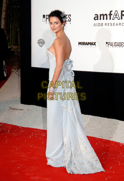 PENELOPE CRUZ.58th Cannes International Film Festival: Cinema Against AIDS 2005 in aid of amfAR.May 19th, 2005.full length light strapless chopard grey gray purple lilac blue dress bracelet gathered looking over shoulder.www.capitalpictures.com.sales@capitalpictures.com.©Capital Pictures