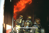 63818-01520 Firefighters fighting fire inside burning house  Kinmundy-Alma Fire District,  Kinmundy IL