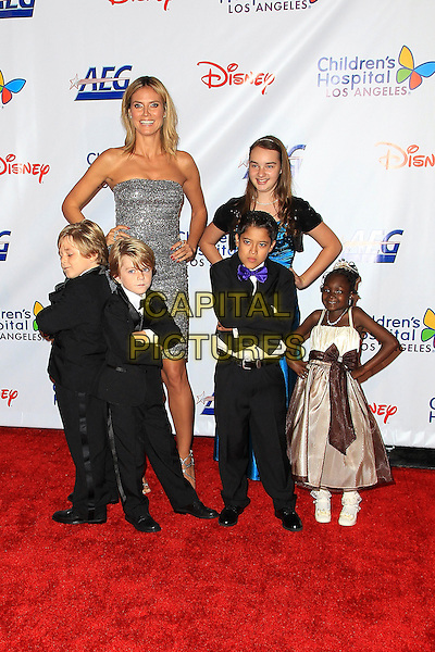 Heidi Klum & guests .Children's Hospital Los Angeles Gala: Noche de Ninos, Los Angeles, California, USA, 20th October 2012..full length dress hands on hips smiling glittery sparkly strapless silver .CAP/ADM/PH.©Paul A. Hebert/AdMedia/Capital Pictures.