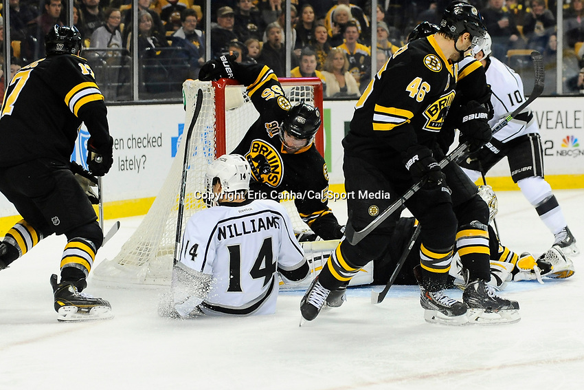 January 20, 2014 - Boston, Massachusetts, U.S. - Boston Bruins defenseman Johnny Boychuk (55) jumps in the net to prevent a score during the NHL game between Los Angeles Kings and the Boston Bruins held at TD Garden in Boston Massachusetts. The Bruins defeated the Kings 3-2 in regulation time.   Eric Canha/CSM