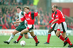 Robbie Fowler of Liverpool tussles with Ian Woan of Nottingham Forest - Premier League - Nottingham Forest v Liverpool - City Ground - Nottingham - England - 23rd March 1996 - Picture Simon Bellis/Sportimage