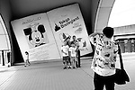 Korean tourists have their photos taken at Tokyo Disneyland in Chiba, Japan..Photographer: Robert Gilhooly