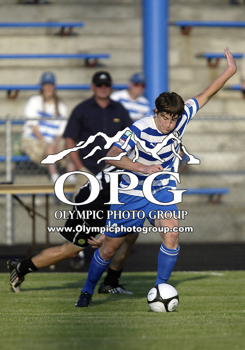 09 June 2009:   Kitsap Pumas forward #14 Stephen Phillips brings the ball up field against the Portland Timbers at Memorial Stadium in Bremerton, WA.  The Portland Timbers won 3-0 over the Kitsap Pumas in the first round of the US Open Cup.