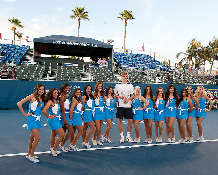 Kevin Anderson (RSA) poses with his trophy and the Volley Girls after his victory over Marinko Matosevic (AUS)  in their Final match today - Kevin Anderson (RSA) def Marinko Matosevic (AUS) 7-5 7-6(4)..ATP 250 Tennis - 2012 Delray Beach International Tennis Championships - Day 7 - Sunday 04 March 2012 - Delray Beach Stadium & Tennis Center - Delray Beach - Florida - USA..