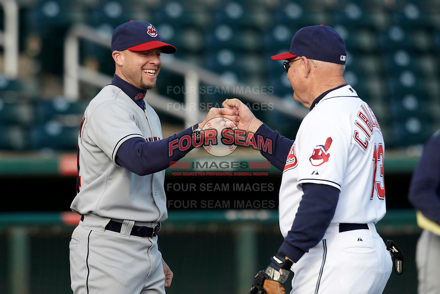 Former major league pitcher Brian Anderson fist bumps a camper during the campers vs pros game at the Cleveland Indians Fantasy Camp at Goodyear Stadium on January 20, 2012 in Goodyear, Arizona.  (Mike Janes/Four Seam Images)