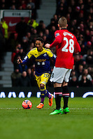 Sunday 05 January 2014<br /> Pictured:Jonathan de Guzman gets the ball past Alexander B?ttner  of Manchester United<br /> Re: Manchester Utd FC v Swansea City FA cup third round match at Old Trafford, Manchester