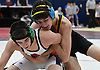 Tyler Podolsky of St. Anthony's, right, battles Liam Houlihan of St. John the Baptist at 126 pounds during the NSCHSAA varsity wrestling championships at St. John the Baptist High School on Sunday, Feb. 5, 2017. Podolsky won the match.