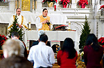 WATERBURY, CT-122517JS03--Christmas Day service  St. Patrick's Church, part of the St. Blaise Parish, in Waterbury on Monday. While the crowd was light due to the weather, the church was filled for the Christmas Eve Mass. <br /> Jim Shannon Republican-American