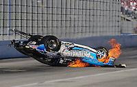 Nov 14, 2010; Pomona, CA, USA; NHRA comp eliminator driver Steve Kent crashes on fire during the Auto Club Finals at Auto Club Raceway at Pomona. Mandatory Credit: Mark J. Rebilas-