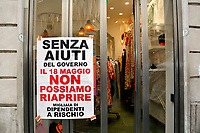Closed shops exposing banners: Without the help of the Government we can't reopen<br /> Roma May 18th 2020. Covid-19 Italy further relaxes lockdown. Today a Council of Minister's decree will allow almost all the activity to reopen. Clothes shops, shopping centers, hairdresser and churches for religious services. <br /> Photo Samantha Zucchi Insidefoto