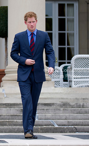 Prince Harry arrives for a reception at the British Ambassador's Residence in recognition of U.S. and British wounded warriors, in Washington, D.C. on May 7, 2012. .Credit: Kevin Dietsch / Pool via CNP