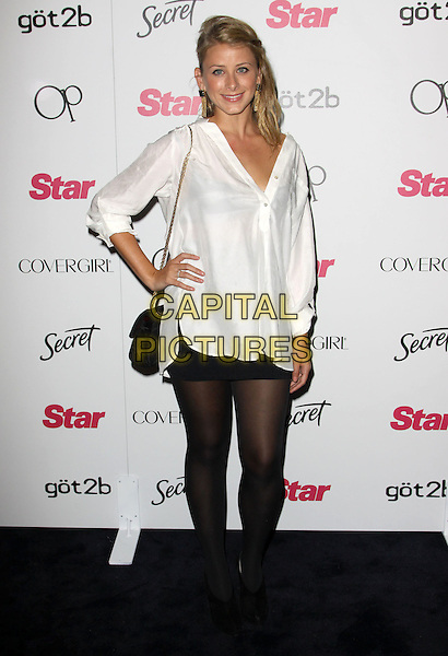 LO BOSWORTH (LAUREN BOSWORTH).Star Magazine's 5th Year Anniversary Celebration held At Bardot,   Los Angeles, California, USA, .13 October 2009..full length white shirt black mini skirt tights hand on hip booties ankle shooboots shoe boots .CAP/ADM/KB.©Kevan Brooks/AdMedia/Capital Pictures.