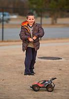 NWA Democrat-Gazette/BEN GOFF @NWABENGOFF<br /> Hunter Chandler, 7, of Bentonville drives his remote controll car Wednesday, Jan. 10, 2018, at Memorial Park in Bentonville. Chandler and his younger brother received the cars for Christmas.