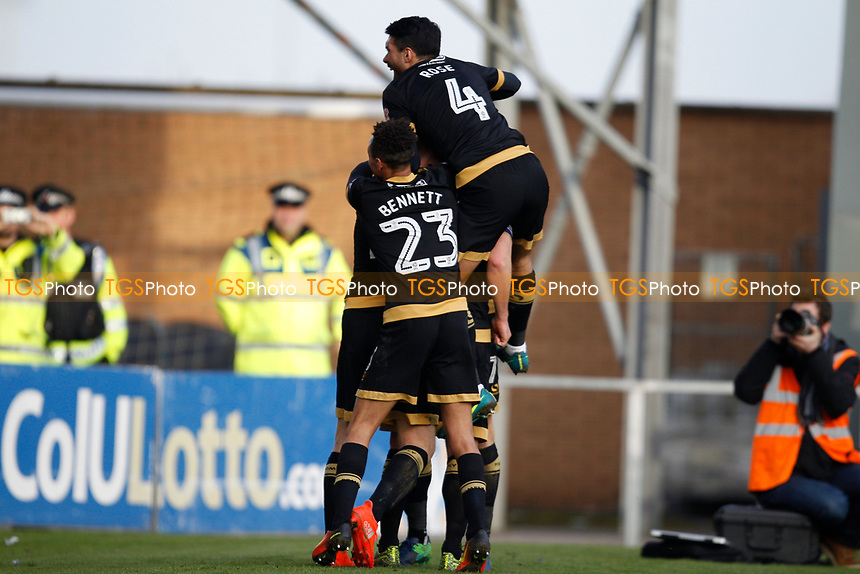 Portsmouth players celebrate the third goal in front of their travelling support during Colchester United vs Portsmouth, Sky Bet EFL League 2 Football at the Weston Homes Community Stadium on 11th March 2017