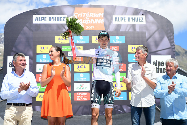 Emanuel Buchmann (GER) Bora-Hansgrohe retains the young riders white jersey on the podium at the end of Stage 7 of the Criterium du Dauphine 2017, running 168km from Aoste to Alpe d'Huez, France. 10th June 2017. <br /> Picture: ASO/A.Broadway   Cyclefile<br /> <br /> <br /> All photos usage must carry mandatory copyright credit (&copy; Cyclefile   ASO/A.Broadway)