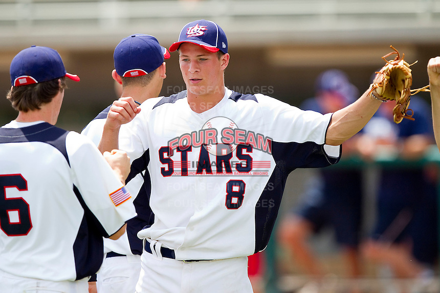 Jared Price #8 of STARS high fives teammates after closing out the win over NABF at the 2011 Tournament of Stars at the USA Baseball National Training Center on June 25, 2011 in Cary, North Carolina.  The Stars defeated NABF 7-1.  (Brian Westerholt/Four Seam Images)