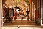 Arcade shopping street along waterfront in Bellagio, Italy on Lake Como
