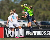 Sanford, FL - Saturday Oct. 14, 2017:  The Pride goalkeeper rises above an opponent to break up a cross during a US Soccer Girls' Development Academy match between Orlando Pride and NC Courage at Seminole Soccer Complex. The Courage defeated the Pride 3-1.