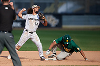 UCF Knights second baseman Matthew Mika (14) throws to first as Scottie O'Bryan (19) slides in during a game against the Siena Saints on February 17, 2019 at John Euliano Park in Orlando, Florida.  UCF defeated Siena 7-1.  (Mike Janes/Four Seam Images)