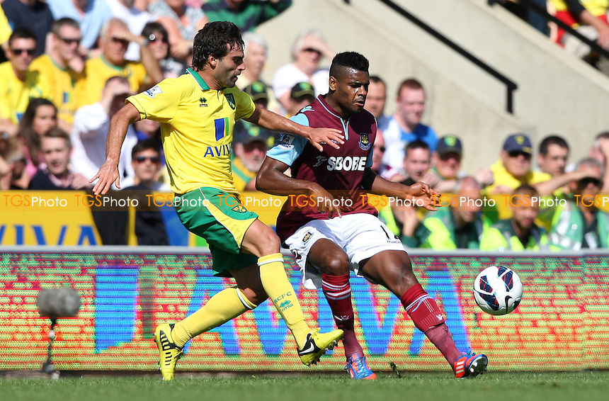 Ricardo Vaz Te of West Ham and Javier Garrido of Norwich - Norwich City vs West Ham United, Barclays Premier League at Carrow Road, Norwich - 15/09/12 - MANDATORY CREDIT: Rob Newell/TGSPHOTO - Self billing applies where appropriate - 0845 094 6026 - contact@tgsphoto.co.uk - NO UNPAID USE.