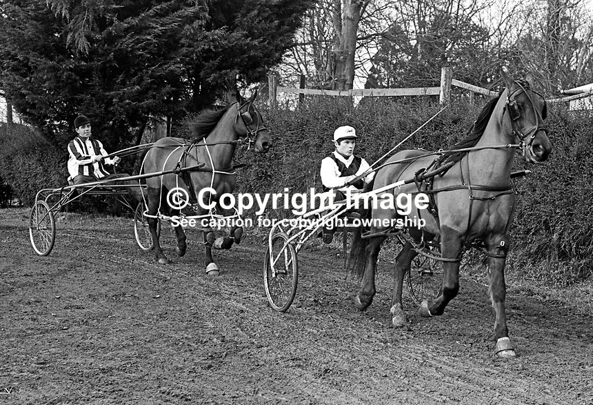 Jack Hewitt, Cusick Street, Belfast, N Ireland, left, and James McFarland, 16 years, Pond Park, Lisburn, N Ireland, sulky racers aka carriage racers, exercise their horses February 1968. 196802000094JH2+JMF2<br /> <br /> Copyright Image from Victor Patterson, 54 Dorchester Park, Belfast, UK, BT9 6RJ<br /> <br /> t: +44 28 9066 1296<br /> m: +44 7802 353836<br /> vm +44 20 8816 7153<br /> <br /> e1: victorpatterson@me.com<br /> e2: victorpatterson@gmail.com<br /> <br /> www.victorpatterson.com<br /> <br /> IMPORTANT: Please see my Terms and Conditions of Use at www.victorpatterson.com